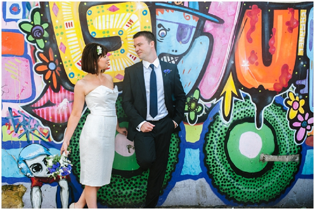 Brighton & Hove | Bride & Groom in front of grafitti wall