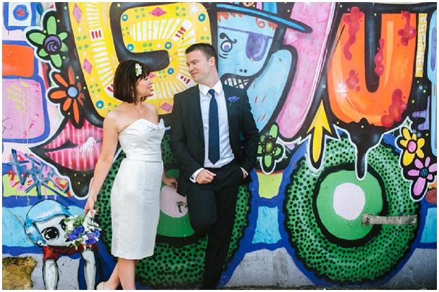 Brighton & Hove | Bride & Groom in front of grafitti wall