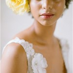 beautiful bride with yellow flower in hair