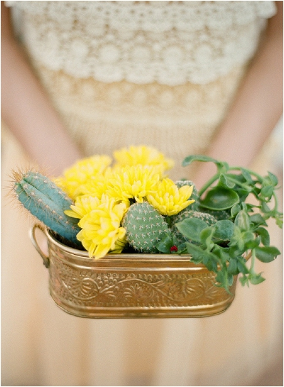 yellow flowers and cactus centrepiece