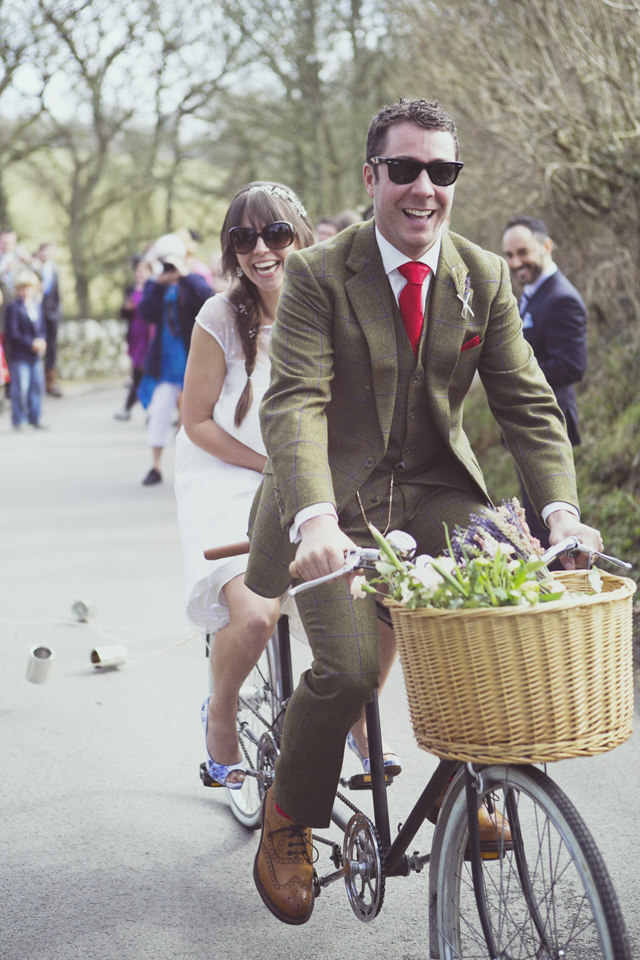 Bride and groom on 70s vintage tandem