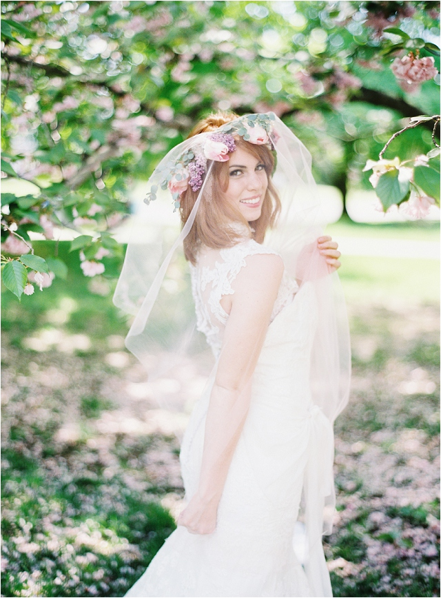beautiful bride with flower crown and veil