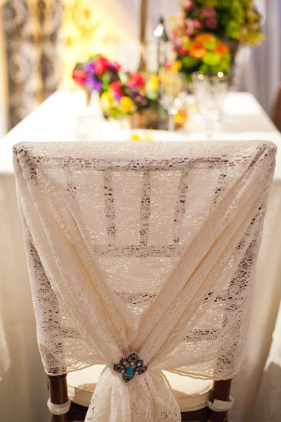 Lace and brooch chair cover