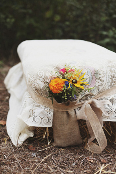 hay stack and lace for wedding ceremony