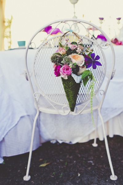 white iron chair with flowers