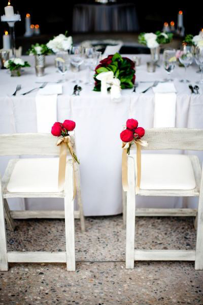 wooden chair with flower posy and ribbon