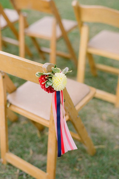 wooden chair with flowers and ribbons