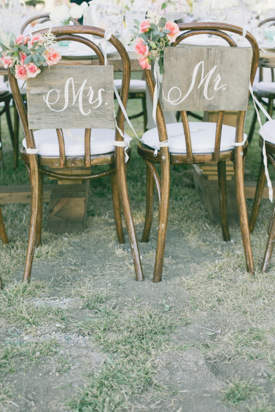 wooden chair with Mr & Mrs signage and flowers