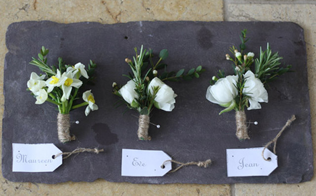 wedding-corsages-with-twine-on-slate