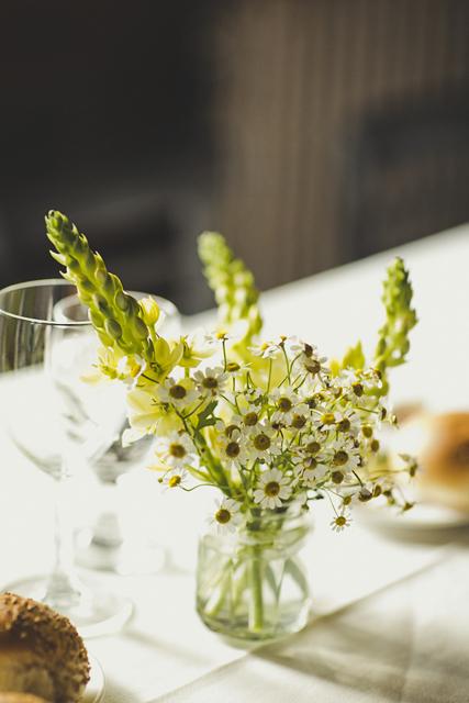 pretty wedding daisies in glass jar