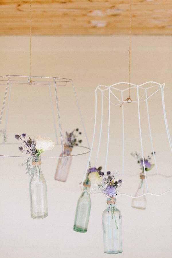 hanging bottles from lampshades