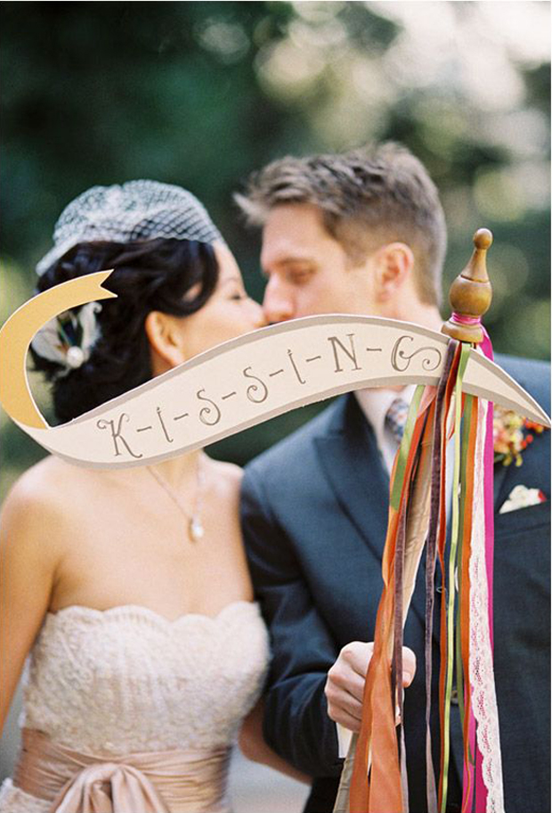bride & groom kissing signage