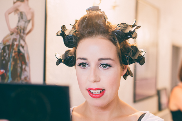 bride getting ready in rollers and re lips