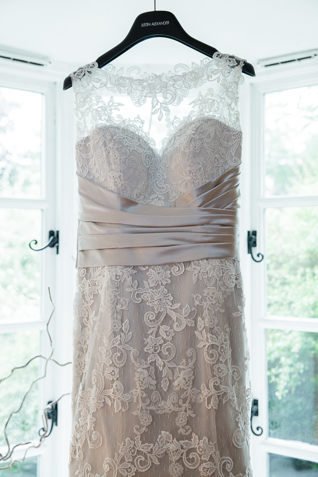 Romantic lace Justin Alexander wedding dress with hint of blush