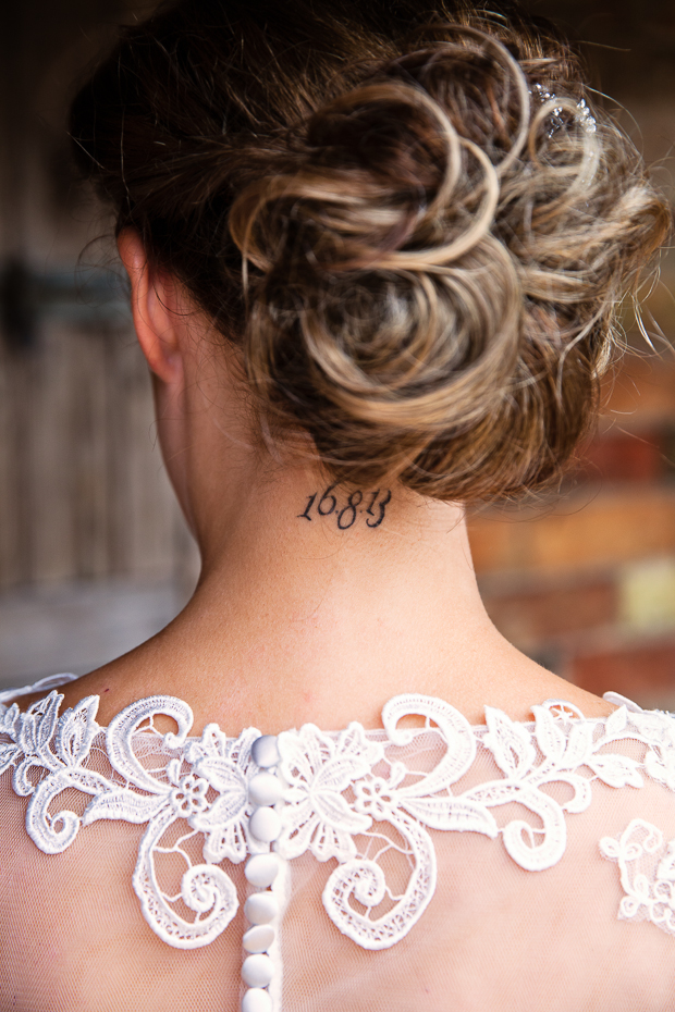 bride with wedding date tattoo on the back of neck