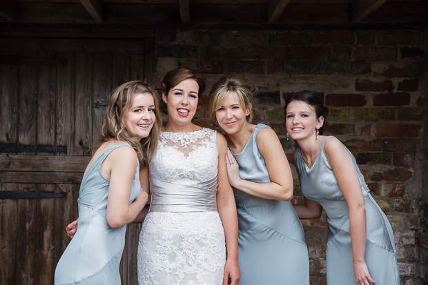 bride with bridesmaids in powder blue long dresses