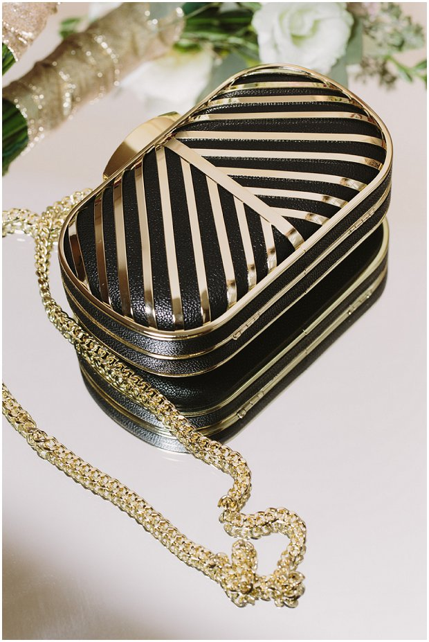 black and gold art deco inspired bridal clutch