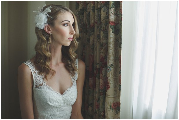 art deco inspired bride wearing art deco earring and feather fascinator