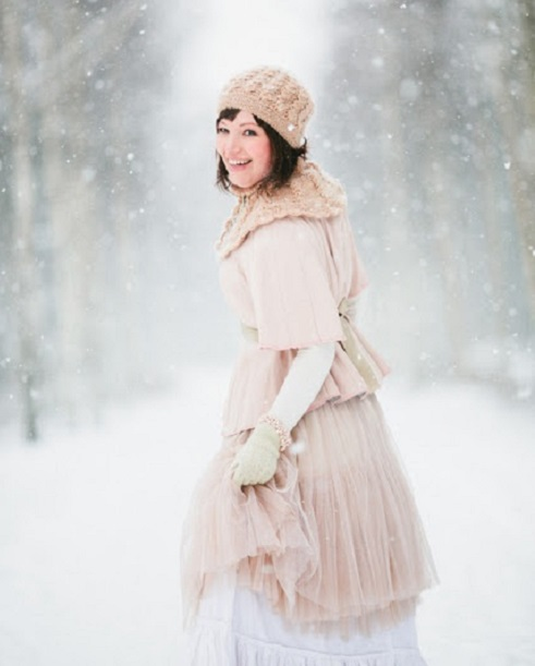 bride in scarf and gloves and hat