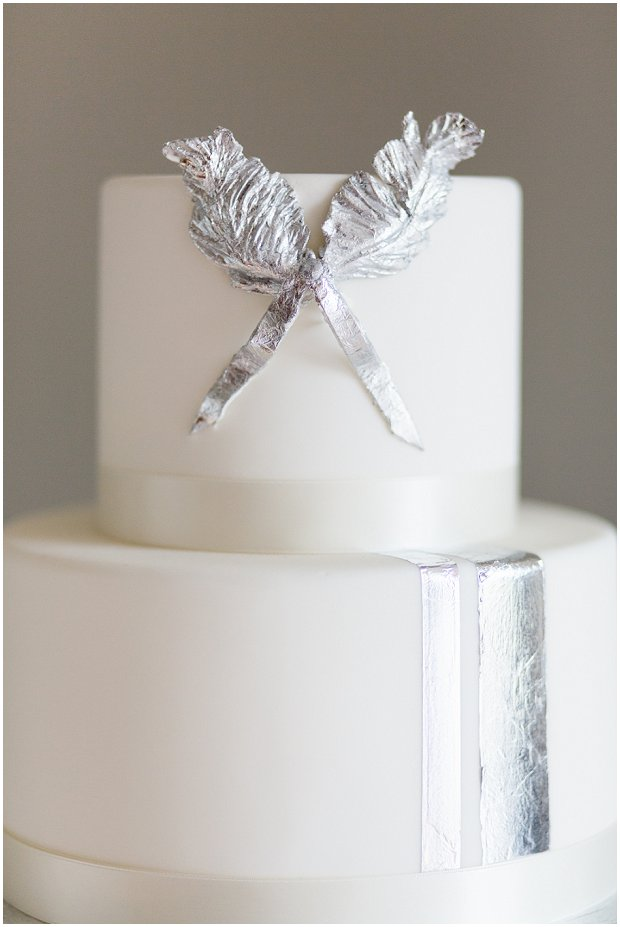 modern wedding cake with metallic silver