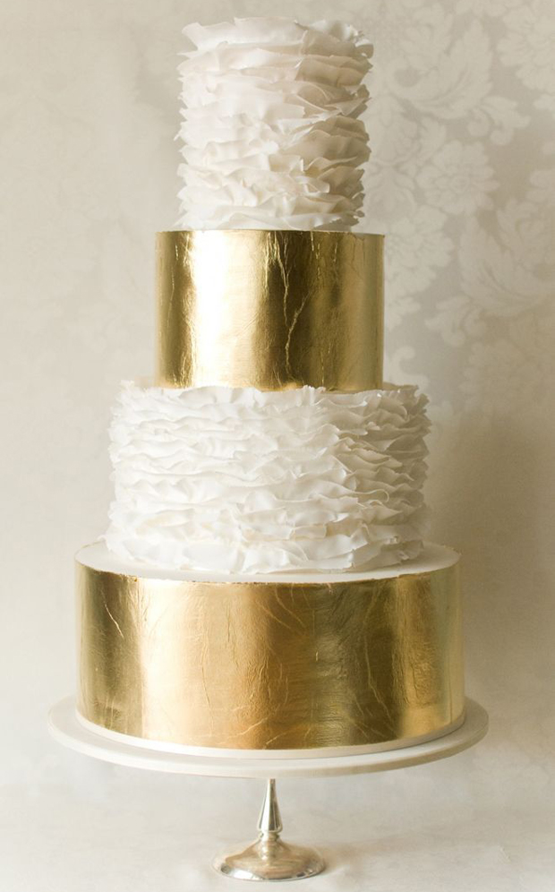 gold leaf layers and white ruffles for modern wedding cake