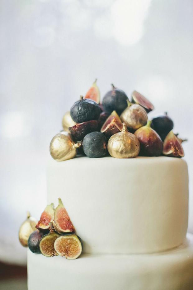gold sprayed figs on wedding cake