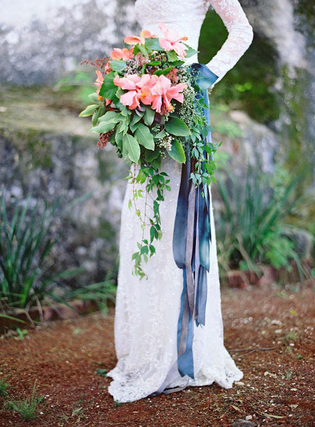 coral bouquet with blue and gray ribbons