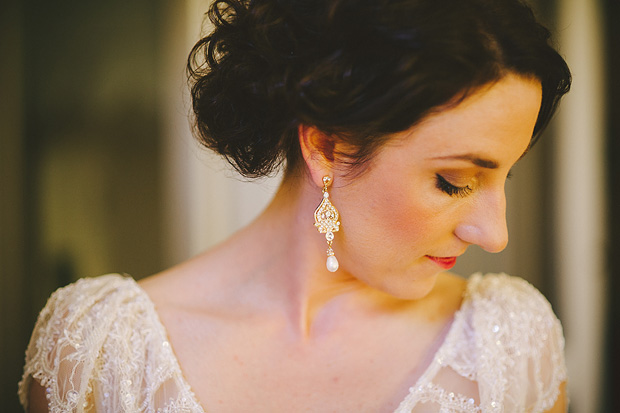 Antique style wedding dress with lace and chandelier earings