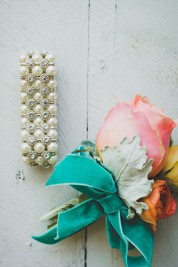 turquiose floral button hole for groomsmen