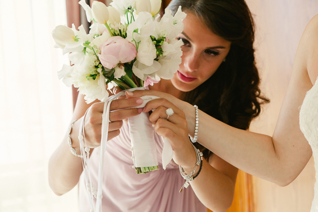pretty tulips, freesia and peony wedding bouquet with white ribbon