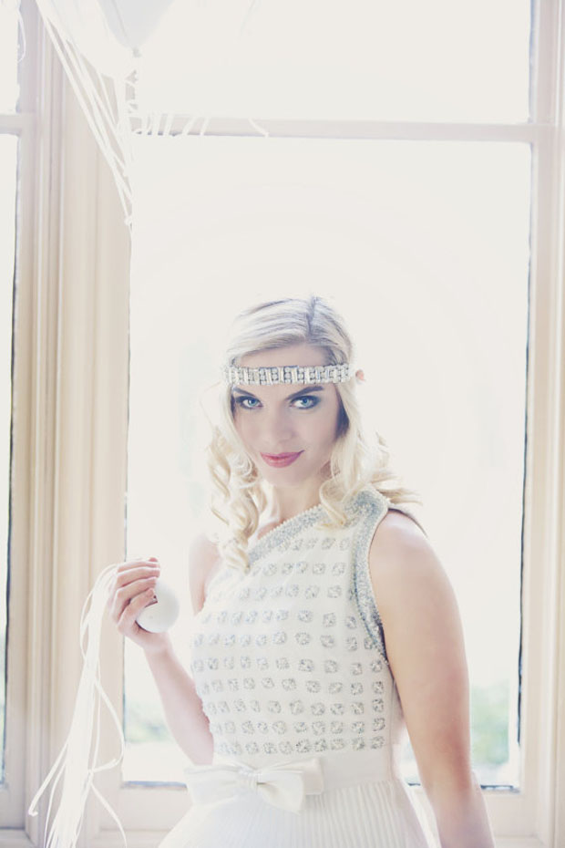 Art Deco forehead band in a geometric pattern with the finest glass crystals embroidered onto ivory illusion tulle
