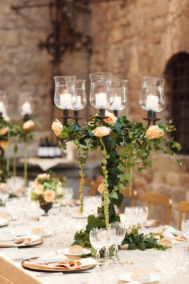 foliage around centrepiece florals and candelabra