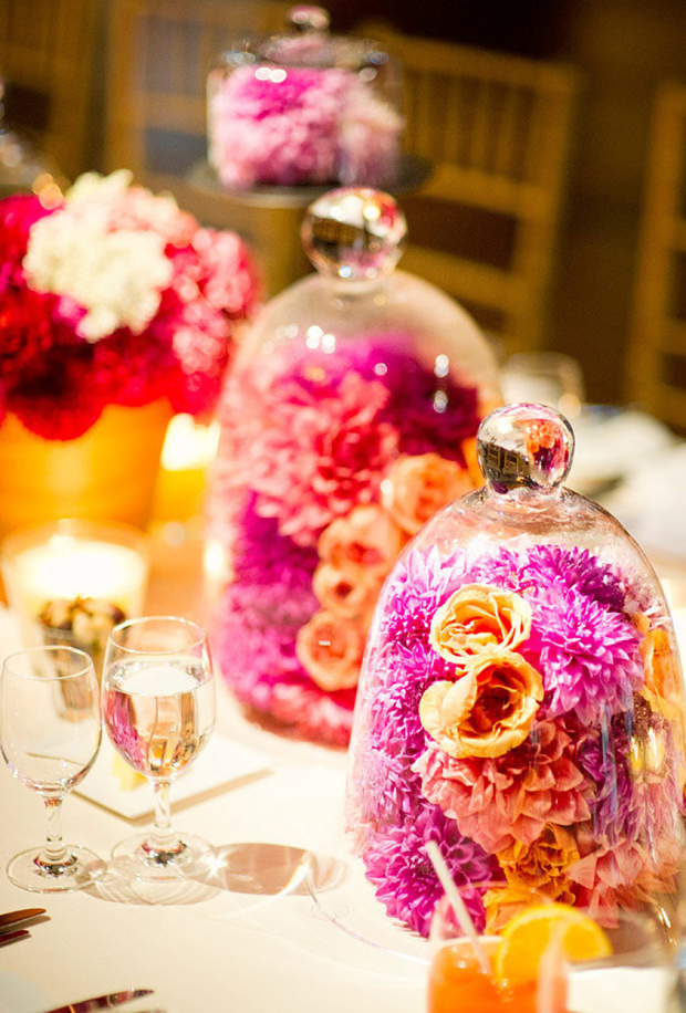 Colourful flowers under glass cloche centerpiece for weddings