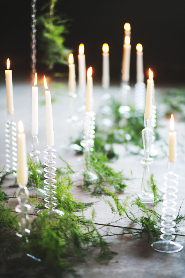 fern foliage and glass candelabra wedding centerpieces