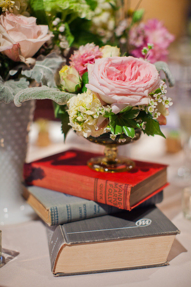 vintage books and florals as centrepieces