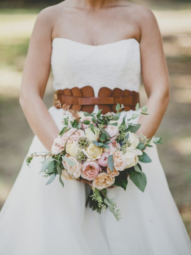 bride wearing brown leather belt and dress