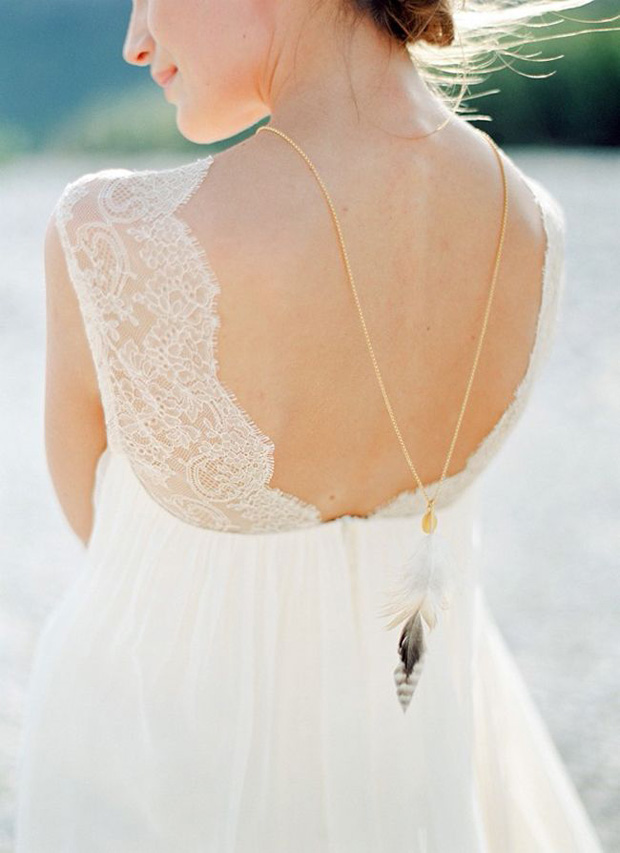 back necklace with stone and feather