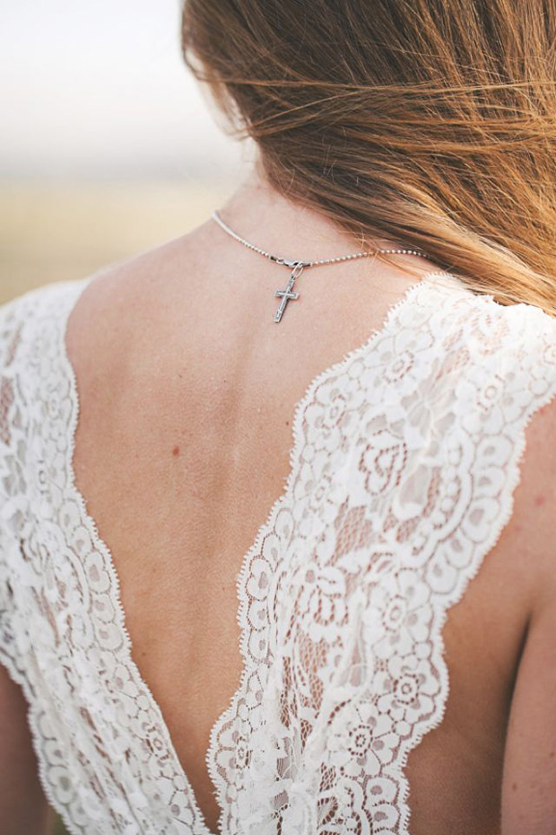 cross backwards necklace