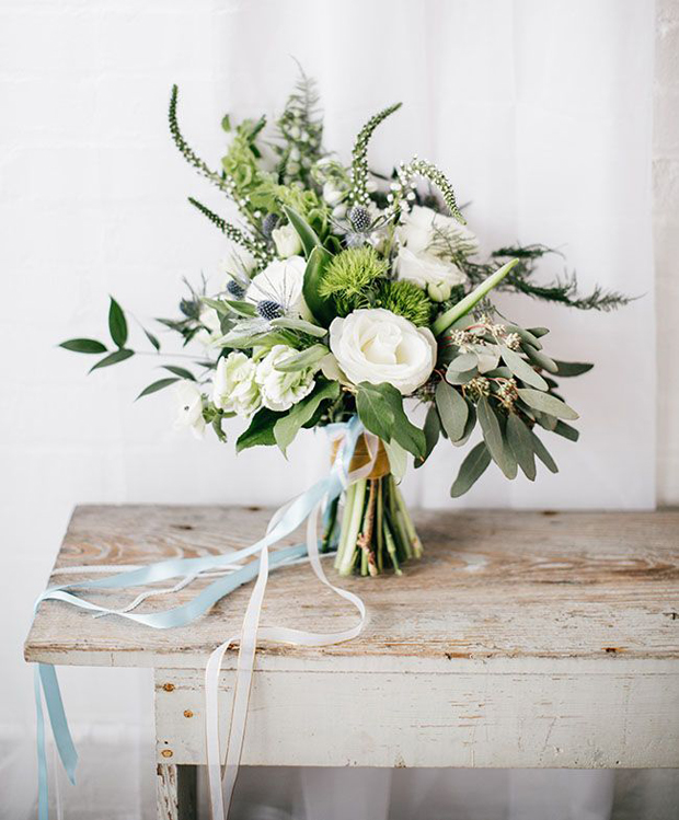 organic wedding bouquet with sky blue ribbons