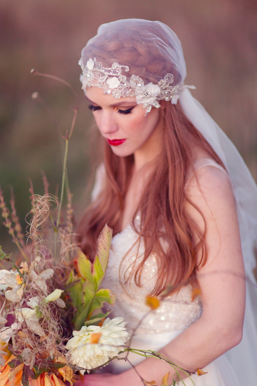 A Wild & Magical Bridal Shoot in Scotland with Feathers and Warm Colour Palette