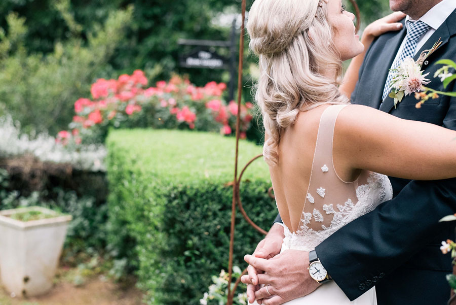 A Pretty Blush Pink Wedding with Proteas, Bunting & Lace: Mike & Zoe
