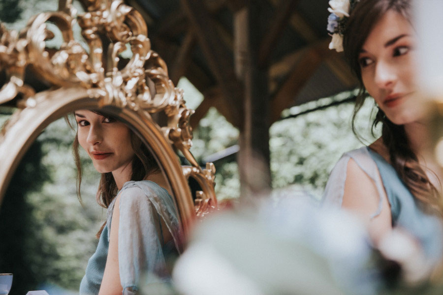A Winter Themed Alice in Wonderland Bridal Shoot With Pale Blue & Deep Red
