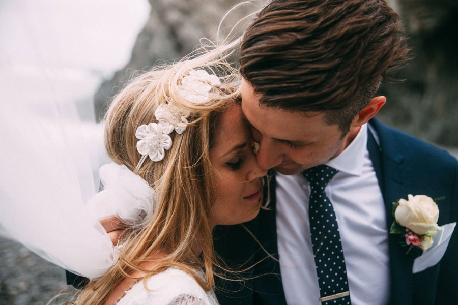 1960s Vintage Boho Wedding at Tunnels Beaches: Nickie & Liam
