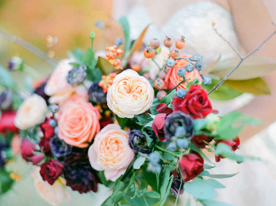 Vibrantly Rich Forest Editorial bouquet close up with cream rose