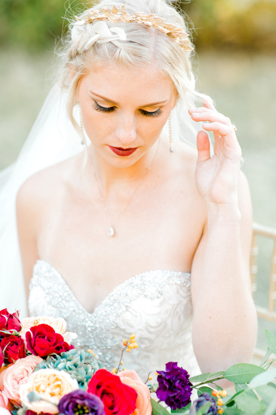 Vibrantly Rich Forest Editorial bride looking down