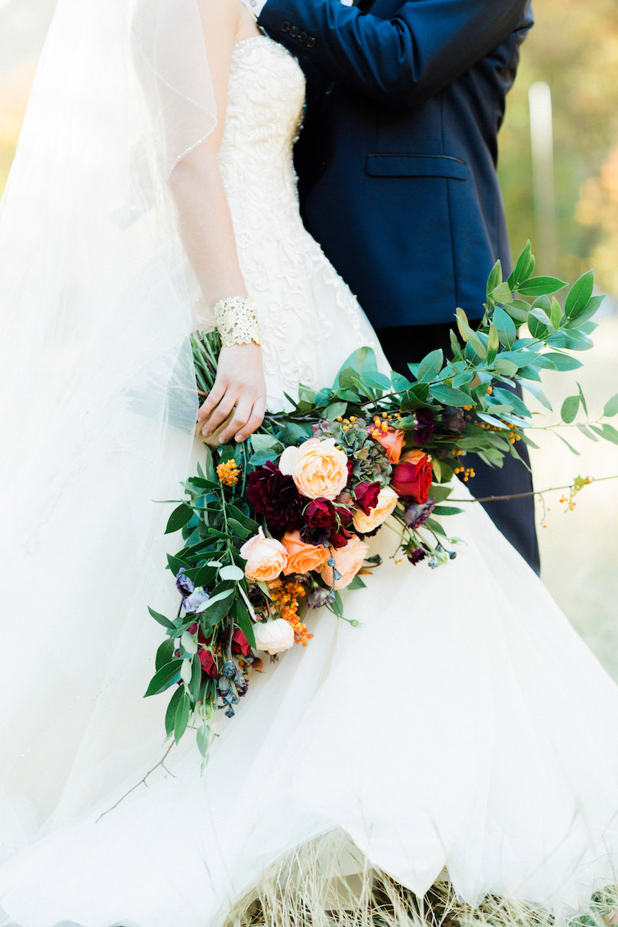 Vibrantly Rich Forest Editorial bride with bouquet and bracelet