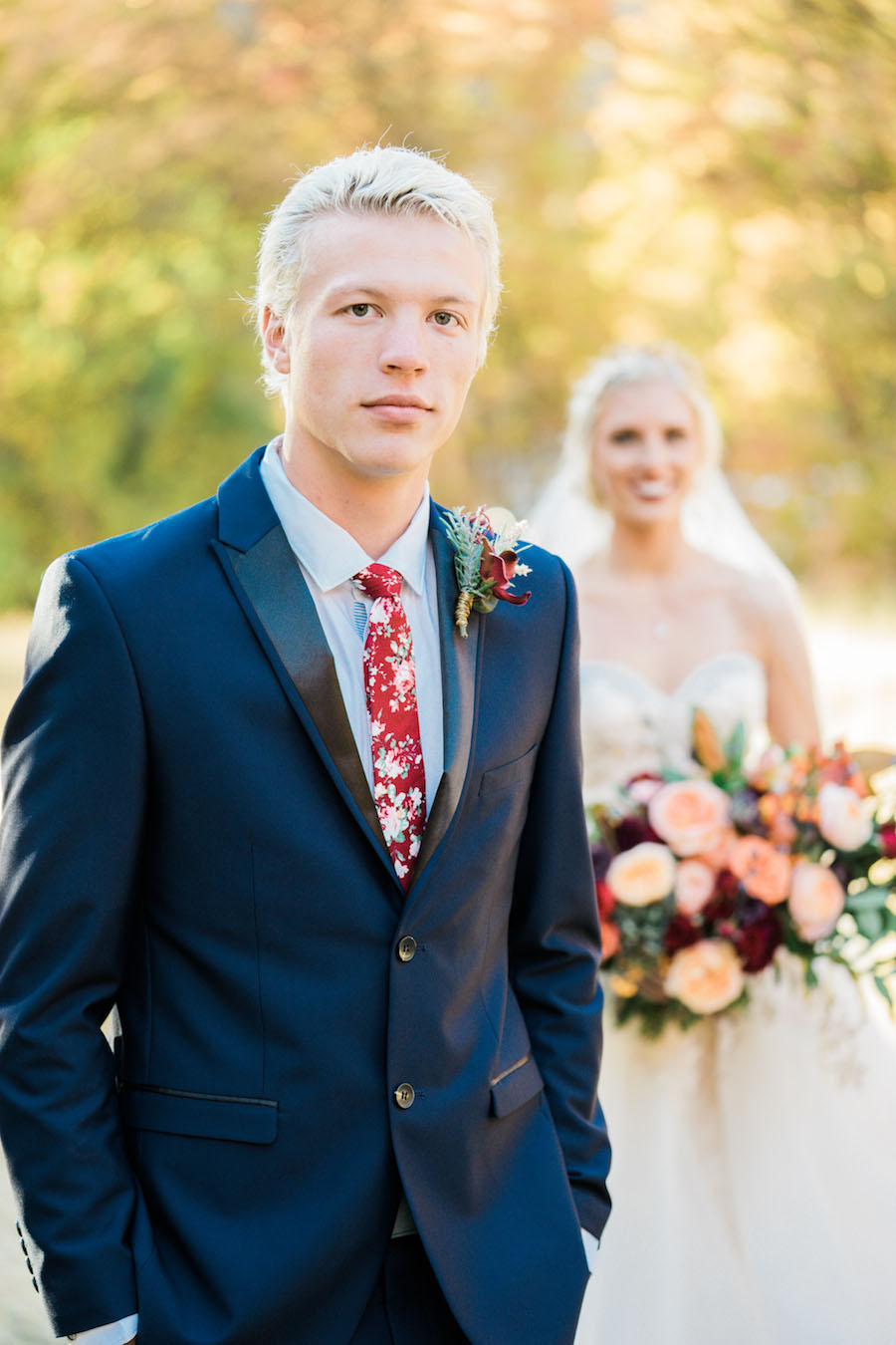 Vibrantly Rich Forest Editorial groom's suit with red tie