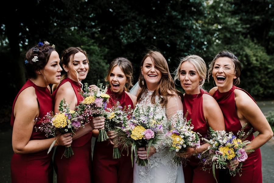 A Yolan Cris Wedding Dress & Red Bridesmaid Jumpsuits Real Wedding: Lauren & Joe
